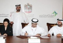 Dr. Maha Barakat, director-general of the Health Authority - Abu Dhabi (HAAD), Abdul Rahman bin Mohammed Al-Owais, minister of health, and Essa Al-Maidoor, director-general of the Dubai Health Authority (DHA) signing the agreement for the unification of licenses for medical practitioners in the country in the presence of Sheikh Mohammed bin Rashid Al-Maktoum, the ruler of Dubai. (AN photo)