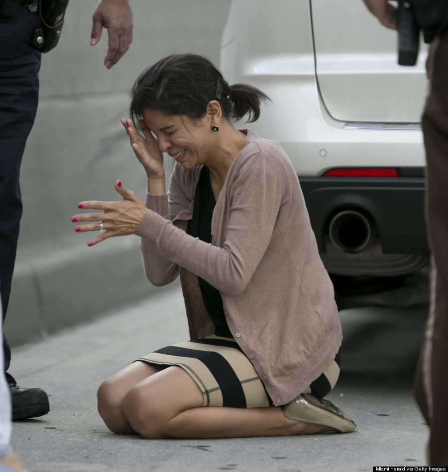 A distraught Pamela Rauseo reacts after performing CPR on her nephew, 5-month-old Sebastian de la Cruz, who stopped breathing. Photo: Al Diaz/Miami Herald