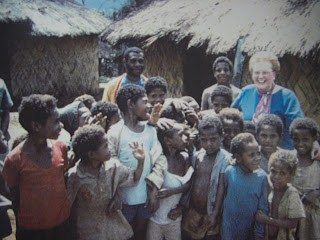 Leininger together with a group of Gadsup children on a return trip to Papua New Guinea probably in 1990.
