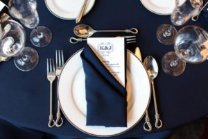 Local businesses donated services including table settings and menu cards for the wedding reception.
