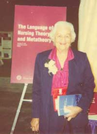 King at the STTI 34th Biennial Convention in Indianapolis, IN., December 3-4, 1997 at the book signing for her and Dr. Jacqueline Fawcett, The Language of Nursing Theory and Metatheory published by STTI in 1997.