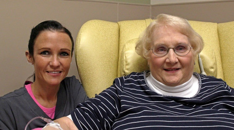 In this Dec. 22, 2015 photo, nurse Nicole Krahn, left, poses with near semi-retired nurse Lynn Bartos at Froedtert & the Medical College of Wisconsin in Wauwatosa, Wis. Krahn is now caring for Bartos during her three-hour appointments for rheumatoid arthritis treatment. The two have switched roles from more than 25 years ago, when Bartos cared for Krahn as a toddler. (AP Photo/Carrie Antlfinger)