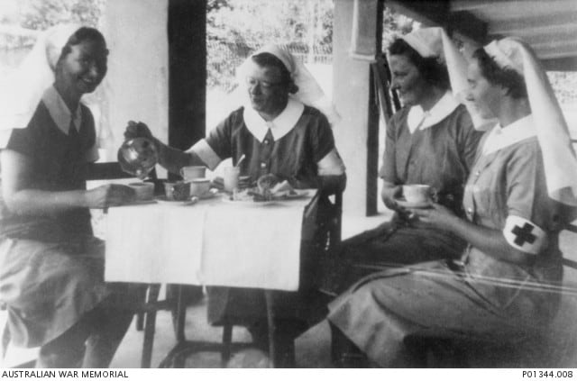 Bullwinkel, Matron Irene Drummond, M. Anderson, M. Selwood enjoy a cup of tea on the verandah of ward C1. The hospital was located in an unfinished mental hospital about seven miles north of Johor Bahru.