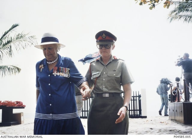 Colonel Coralie Gerrard, Royal Australian Army Nursing Corps (right) escorts Vivian Statham (nee Bullwinkel), after laying a wreath, away from the memorial commemorating the Australian Army Nursing Service (AANS) nurses who died at the hands of the Japanese in the Banka Island massacre on 15 February 1942. Source: awm.gov.au