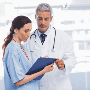 Nurse discussing with doctor