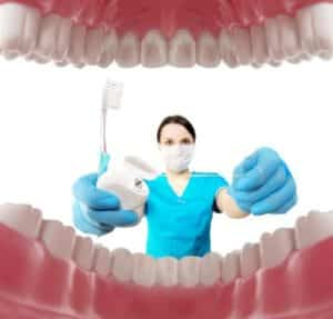 Dentist with tools. Concept of dentistry, whitening, oral hygiene, teeth cleaning with toothbrush, floss. Dentistry, taking care of a beautiful and healthy smile. Dental tooth care clinic. Stomatology