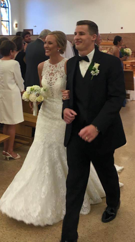 HERO IN WHITE: Julie Stroyne and Andrew Nixon walking down the aisle for the first time as husband and wife.