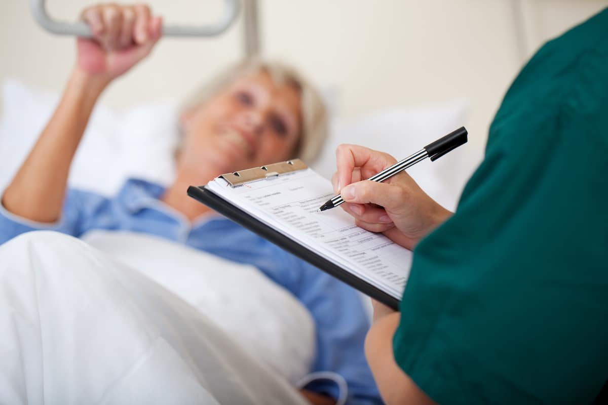 Nurse assessing a patient for a care plan (NCP)