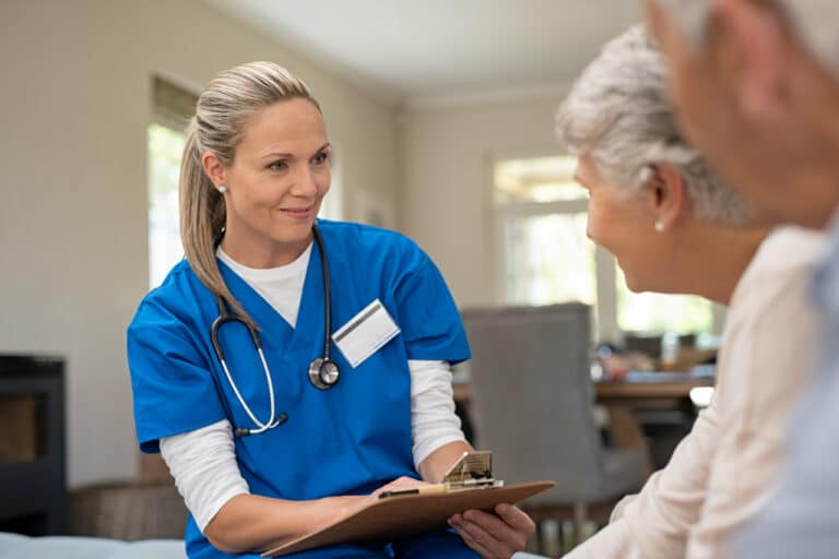 Friendly nurse practitioner assessing a patient during interview.